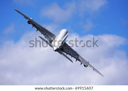 airliner flight over a cloud covered background - stock photo