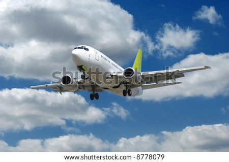 Airliner flying in a blue and cloudy sky. - stock photo