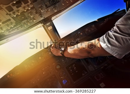 Airliner pilot at work - view from the cockpit - stock photo