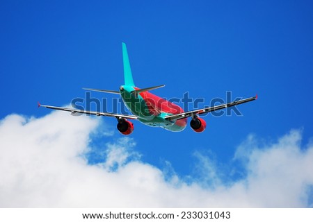 Airliner silhouette on cloudscape background - stock photo