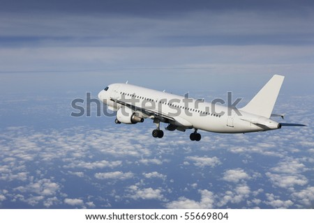 airliner taking off in a cloudy sky - stock photo