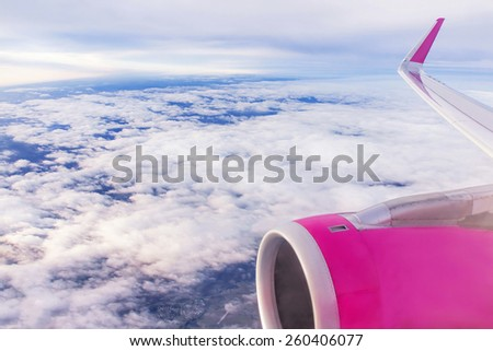 Airplane (aircraft ) is in the sky. Clouds over ground and line of horizon. World�¢??s travel, trip, air transport concept. Day, outdoor. - stock photo