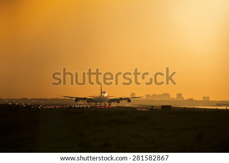 Airplane Almost landed during sunrise. - stock photo