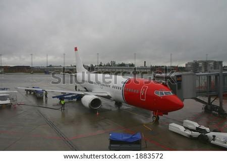 Airplane at Gardemoen airport in Norway - stock photo