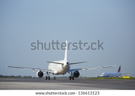 Airplane at the runway - copy space - stock photo