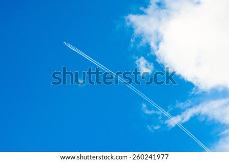 Airplane aviation airport contrail the clouds - stock photo
