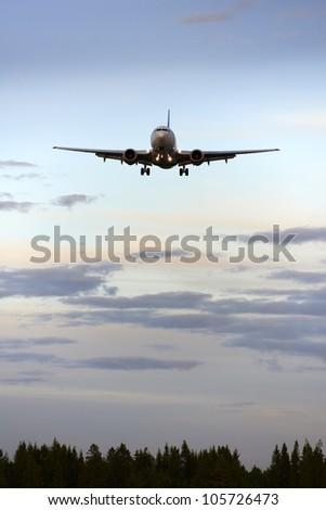 Airplane before landing - stock photo