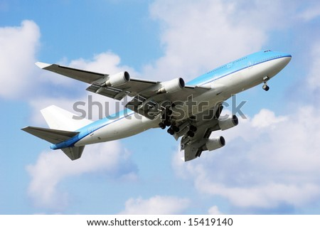 Airplane Blue 747 - stock photo