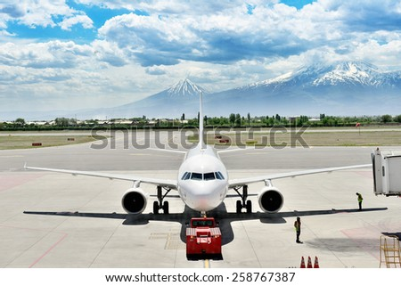 Airplane close to gate bridge - stock photo