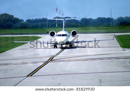 Airplane Coming In on Runway - stock photo