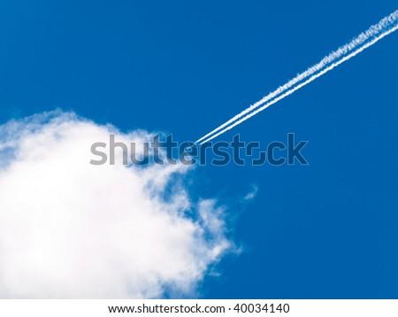 Airplane condensation line - stock photo