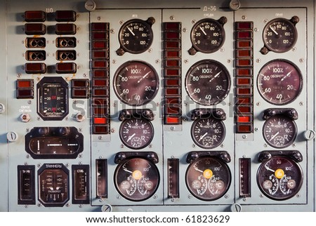 airplane dash board, lots of dials - stock photo