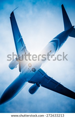 airplane fly through the sky. - stock photo