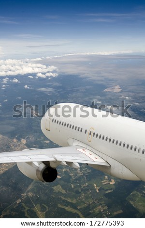 airplane flying above the earth - stock photo