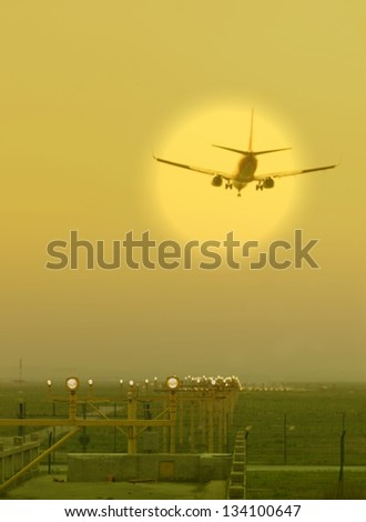 Airplane flying at airport in the sunset,shanghai,China - stock photo