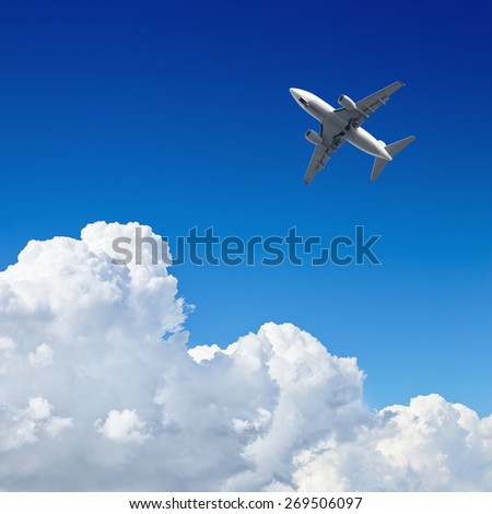 Airplane flying in the blue sky with clouds - stock photo