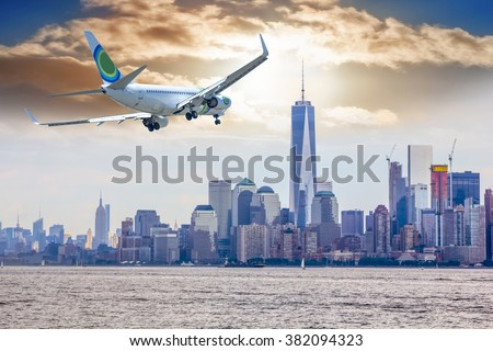 Airplane flying over  New York City.  - stock photo