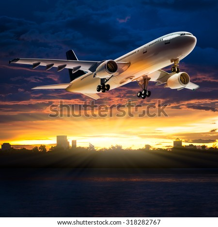 Airplane for transportation flying over the river in the beautiful sunset background - stock photo