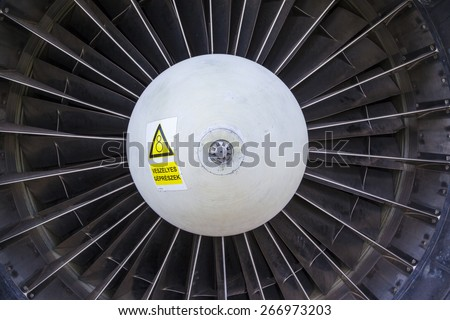 Airplane gas turbine engine detail Gas Turbine Jet Engine with Hungarian  warning label on it. - stock photo