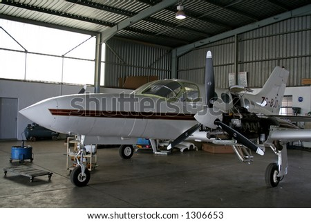Airplane getting repairs - stock photo