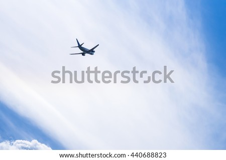 Airplane in Clouds. Airplane after taking-off on the background of cloudscape. Copy Space and Background Photo.  - stock photo