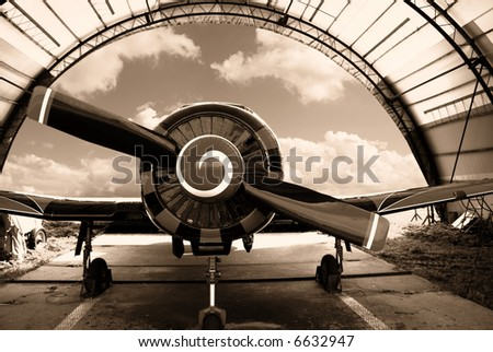 Airplane in the hangar - stock photo