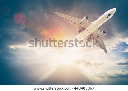 Airplane in the sky at sunset. Amazing trip. Travel concept.  - stock photo