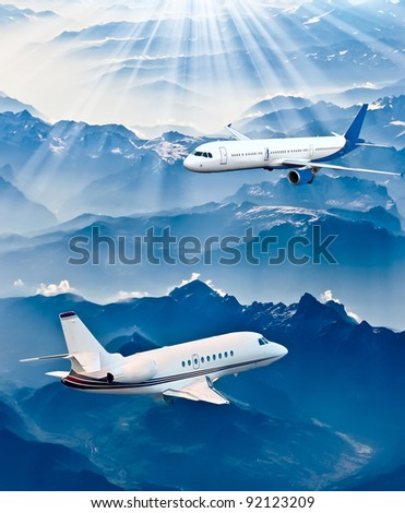 Airplane in the sky - Passenger Airliner / aircraft. Airplane on blue sky.Airplane over the mountains - stock photo