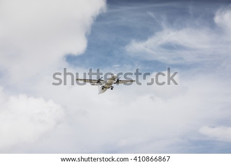Airplane in the sky, Passenger airliner flying high above the clouds - stock photo