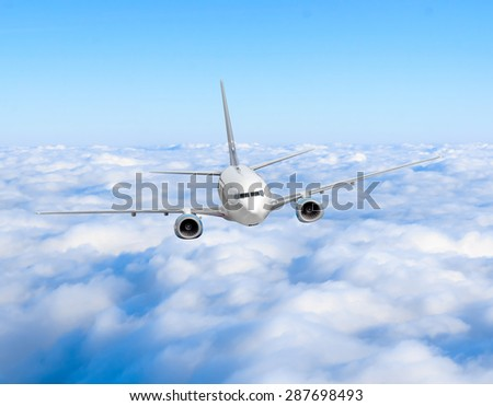 airplane in the sky. Passenger jet air plane flying on blue sky white clouds background - stock photo
