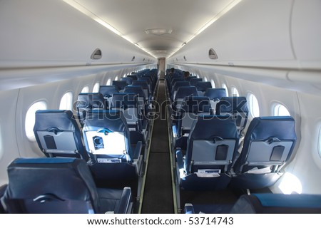 airplane interior and seats in perspective aisle - stock photo