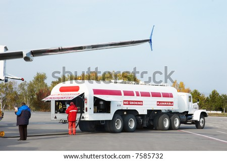 airplane is being refueled in the airport - stock photo