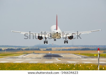 Airplane is landing at the airport - stock photo