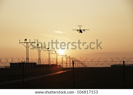 Airplane is landing on Prague Airport, Czech Republic - stock photo
