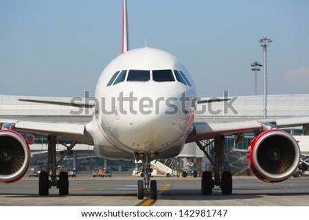 Airplane is taxiing at the airport - selective focus - stock photo