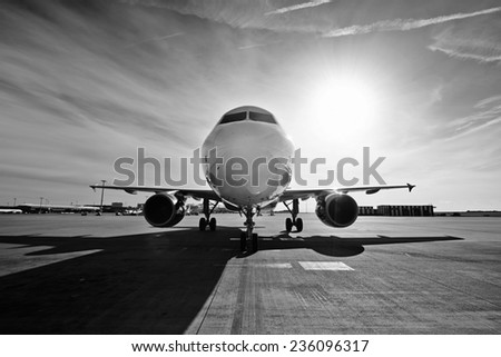Airplane is taxiing to take off at the sunrise - stock photo