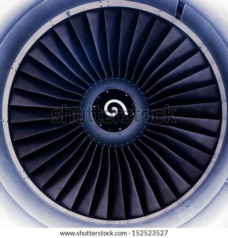 airplane jet engine turbine blades toned in blue - stock photo