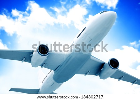 Airplane mid in the air. - stock photo