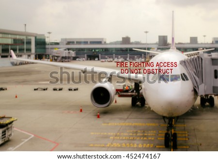 Airplane near departure gate when waiting boarding to flight in airport transit hall and looking through the window ready to travel. Wanderlust lifestyle concept - stock photo
