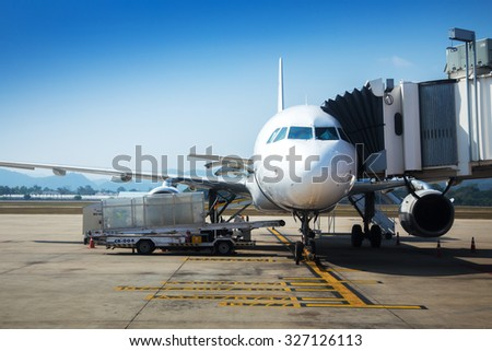 Airplane near terminal. - stock photo