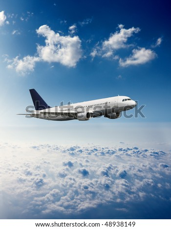 Airplane on a blue and cloudy sky - stock photo