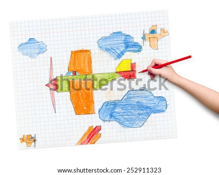 airplane on checkered paper. children drawing hand with crayon. - stock photo