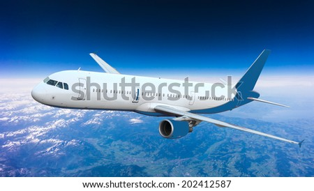 Airplane over the clouds - stock photo
