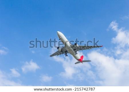 airplane overhead flying - stock photo