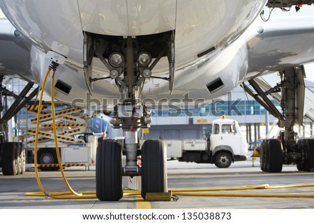 Airplane parked at the airport - stock photo