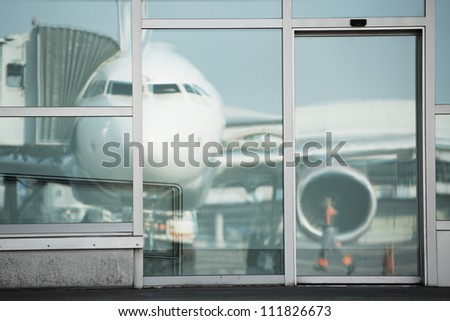 Airplane parked at the airport gate, Prague, Czech Republic - stock photo