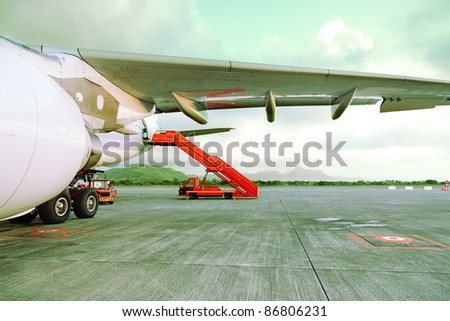 Airplane parked in airport before passengers boarding - stock photo