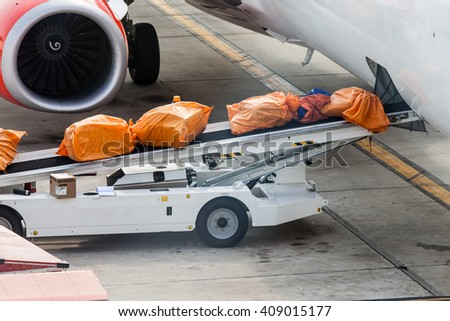 Airplane prepare for fight and loading the bags at the airport - stock photo