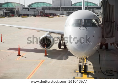 airplane preparing for fly - stock photo