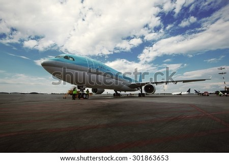 Airplane stands at the airfield - stock photo